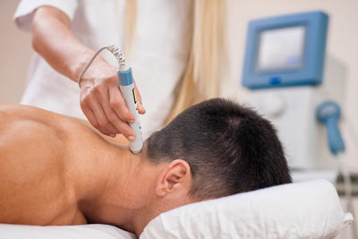 Patient receiving cold laser therapy for a neck injury